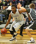SIOUX FALLS, SD - DECEMBER 8:  Kebu Johnson #4 from the University of Sioux Falls drives against Ryan Bruggeman #3 from Southwest Minnesota State Tuesday night at the Stewart Center. (Photo by Dave Eggen/Inertia)
