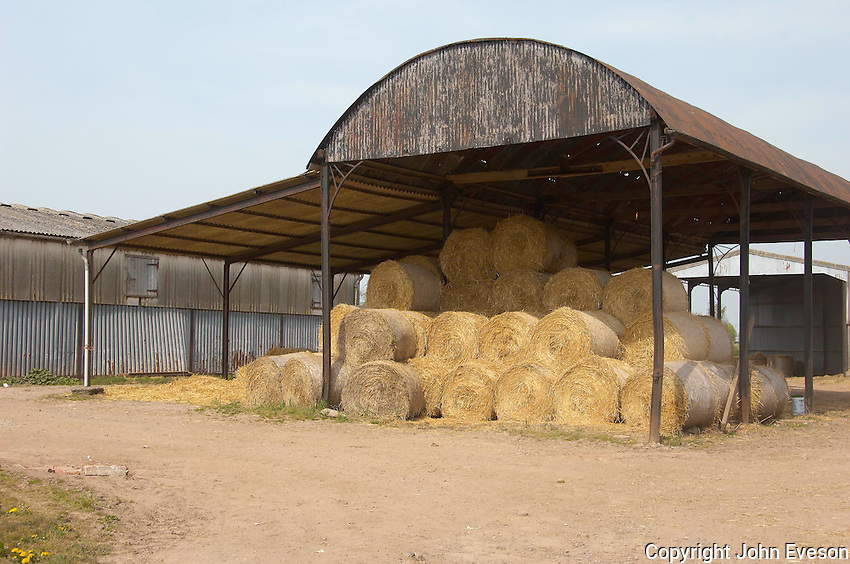 Dutch barn with round bales of straw, Herefordshire.
