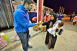 Daniel Fekete from ACT Alliance member Hungarian Interchurch Aid offers fruit to a refugee at Beremend, along Hungary's border with Croatia. Hundreds of thousands of refugees and migrants flowed through Hungary in 2015 on their way to western Europe from Syria, Iraq and other countries.