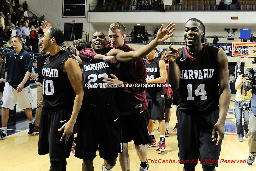 March 7, 2014 - New Haven, Connecticut , U.S. - Harvard Crimson guard Brandyn Curry (10), guard/forward Wesley Saunders (23) and forward Steve Moundou-Missi (14) celebrate after winning the Ivy League title in NCAA basketball game between the Harvard Crimson and the Yale Bulldogs held at the Payne Whitney Gym on the Yale Campus. Harvard beat Yale 7--58 in regulation time. Eric Canha/CSM