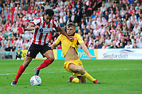 Lincoln City's Matt Green holds off the challenge from Morecambe's Sam Lavelle before scoring his sides equalising goal to make the score 1-1<br /> <br /> Photographer Chris Vaughan/CameraSport<br /> <br /> The EFL Sky Bet League Two - Lincoln City v Morecambe - Saturday August 12th 2017 - Sincil Bank - Lincoln<br /> <br /> World Copyright &copy; 2017 CameraSport. All rights reserved. 43 Linden Ave. Countesthorpe. Leicester. England. LE8 5PG - Tel: +44 (0) 116 277 4147 - admin@camerasport.com - www.camerasport.com
