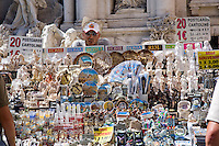 Roma, Luglio 2009. Un venditore di souvenir di fronte la Fontana di Trevi.<br /> A Roma decine di arresti e perquisizioni hanno dato il via a un nuovo scandalo di tangenti che ha visto coinvolti personaggi dello spettacolo, della politica e dello sport Italiani. Questo nuovo caso di corruzione va a colpire ancora di pi&ugrave; una citt&agrave; gi&agrave; ferita da una amministrazione disastrosa.<br /> Rome is increasingly falling down<br /> A toxic mix of mafia gangsters, corrupt politicians and a one-eyed former terrorist made millions in Rome by exploiting migrants and gipsies, it emerged in a scandal that has seriously shaken the capital's faith in its leaders.