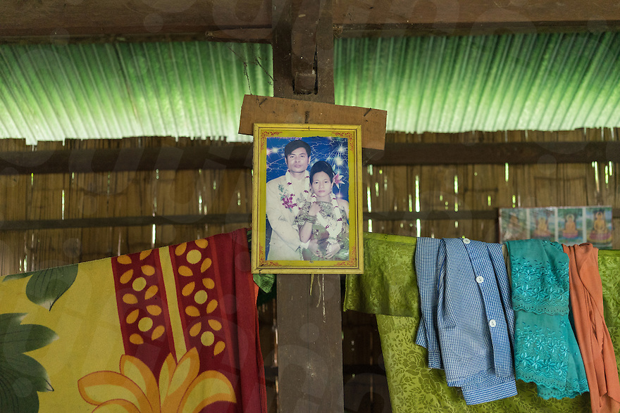 Aug. 17, 2016 - Kbal Romeas (Cambodia). A wedding photo of Je Srey Neang and her husband in her small house in Kbal Romeas. In the last couple of years she and her family fought hard the relocation's plan. She recently divorced from her husband because he wanted to leave the village. © Thomas Cristofoletti / Ruom