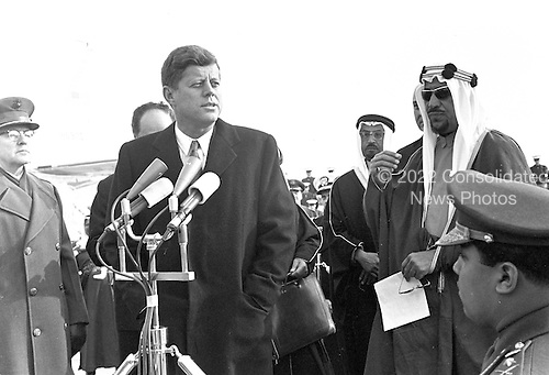 United States President John F. Kennedy welcomes a delegation led by King Saud bin Abdulaziz Al Saud of Saudi Arabia during a ceremony at Andrews Air Force Base, Maryland on February 13, 1962. <br /> Credit: Arnie Sachs / CNP