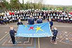 Kerry U21 star Philip O'Connor help Raise the active Flag for Kilmurry National School on Friday. Pictured here are Evan Greaney,Orla O'Connor,Philip O'Connor, Joanne Brosnan, Ashling Kearney and Fergal Enright and Students, Teachers and parents of Kilmurry National School