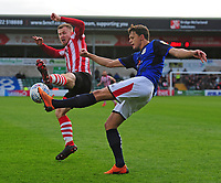 Lincoln City's Michael O'Connor vies for possession with Crewe Alexandra's Perry Ng<br /> <br /> Photographer Andrew Vaughan/CameraSport<br /> <br /> The EFL Sky Bet League Two - Lincoln City v Crewe Alexandra - Saturday 6th October 2018 - Sincil Bank - Lincoln<br /> <br /> World Copyright &copy; 2018 CameraSport. All rights reserved. 43 Linden Ave. Countesthorpe. Leicester. England. LE8 5PG - Tel: +44 (0) 116 277 4147 - admin@camerasport.com - www.camerasport.com
