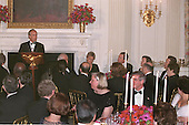 "Governor Dirk Kempthorne (Republican of Idaho), Chairman of the National Governors Association, toasts United States President George W. Bush prior to a formal dinner at the White House in Washington, D.C. on February 22, 2004.   In his remarks, Kempthorne saluted George Washington on his birthday and called President Bush another ""great president called upon to be commander in chief.'' Seated to the right of the president is Governor Arnold Schwarzenegger (Republican of California).<br /> Credit: Brad Markel / Pool via CNP"