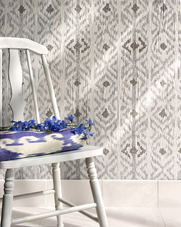 Flagstaff, a hand-cut stone mosaic, shown in hand-chopped tumbled Thassos, Bardiglio, and Cavern, is designed by Paul Schatz as part of the Legend™ collection by New Ravenna.