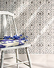 Flagstaff, a hand-cut stone mosaic, shown in hand-chopped tumbled Thassos, Bardiglio, and Cavern, is designed by Paul Schatz as part of the Legend® collection by New Ravenna.