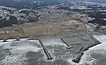 February 26, 2012, Fukushima, Japan - The remains of the tsunami-stricken town of Tomioka, Fukushima Prefecture near the Fukushima No. 1 Nuclear Power Plant appear almost as vacant land in this aerial photo taken from a Mainichi helicopter on Feb. 26, 2012.