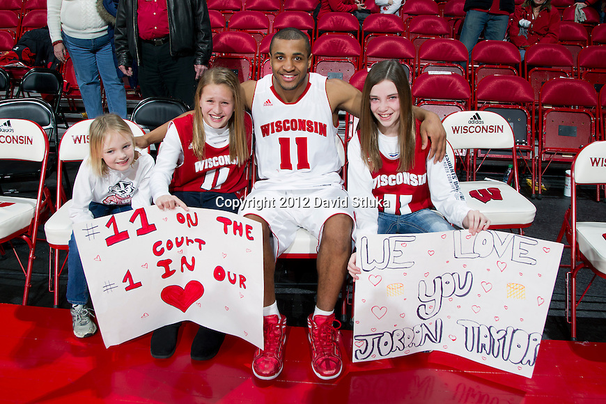 Wisconsin Badgers Jordan Taylor poses with fans after a Big Ten Conference NCAA college basketball game against the Illinois Fighting Illini on Sunday, March 4, 2012 in Madison, Wisconsin. The Badgers won 70-56. (Photo by David Stluka)