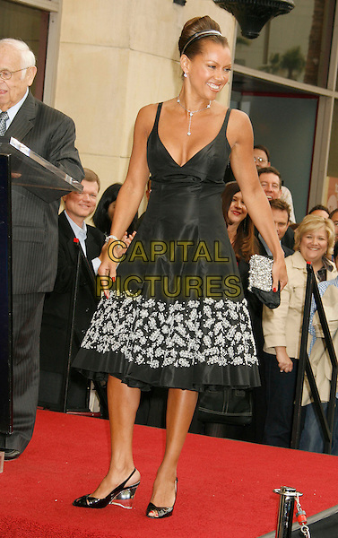 VANESSA L. WILLIAMS.Vanessa L. Williams Celebrates Her Birthday With a Star On The Hollywood Walk of Fame, Holllywood, California, USA..March 19th, 2007 .full length black dress floral print heels clear .CAP/ADM/RE.©Russ Elliot/AdMedia/Capital Pictures