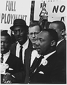 Dr. Martin Luther King, Jr., President of the Southern Christian Leadership Conference, and Mathew Ahmann, Executive Director of the National Catholic Conference for Interrracial Justice, in a crowd in Washington, D.C. on August 28, 1963.  John Lewis is partially obscured at far left.<br /> Credit: National Archives via CNP