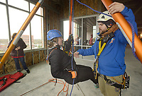 NWA Democrat-Gazette/BEN GOFF @NWABENGOFF<br /> Todd Medeiros of New York, a technical coordinator with Over the Edge, puts rappeller Mary Claire Farnan of Rogers through 'ground school' training Saturday, March 11, 2017, during the Sunshine School &amp; Development Center's rappelling fundraiser with Over The Edge at the 8W Center in Bentonville. The school began a campaign in January, with participants who reached their fundraising goal able to participate in rappelling from the roof of the 6-story building. Over the Edge is a company which specializes in producing events for non profits using equipment and techniques used in commercial rope-access work such as sign installation and window washing. The event had raised more than $57,000 for the school, with more donations still coming in Saturday morning. Located in Rogers, the Sunshine School &amp; Development Center serves children and adults with developmental dissabilities, including a preschool.