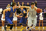 SIOUX FALLS, SD - NOVEMBER 24: Mack Johnson #3 from the University of Sioux Falls picks up the loose ball past Adam Hofer #10 from Dakota State University in the first half of their game Monday night at the Stewart Center.  (Photo by Dave Eggen/Inertia)