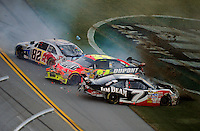 Nov. 1, 2009; Talladega, AL, USA; NASCAR Sprint Cup Series drivers Robby Gordon (7), Jeff Gordon (24) and Scott Speed (82) crash during the Amp Energy 500 at the Talladega Superspeedway. Mandatory Credit: Mark J. Rebilas-