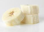 Closeup of banana fruit slices isolated on white background