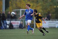 VOETBAL: BOLSWARD: 22-11-2014, SC Bolsward - VV Nijland, uitslag 0-3, Nico Pieter Bonnema (#9) van Nijland in duel met Bozkurt Osman (#2), ©foto Martin de Jong