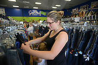Alison Harvey of Belfast, Maine shops at Good Stuff Thrift shop Thursday August 13, 2015 in Fairless Hills, Pennsylvania. (Photo by William Thomas Cain)