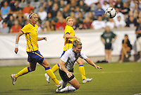 Amy Rodriguez  attempts a diving header...USWNT tied Sweden 1-1 at Morison Stadium, Nebraska.