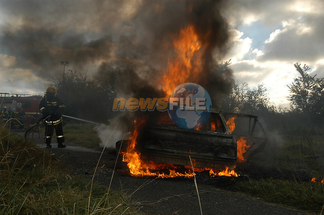 Car fire in Rathmullen.Photo Fran Caffrey/Newsfile.ie...This Picture has been sent to you by Newsfile Ltd..The Studio,.Millmount Abbey,.Drogheda,.Co. Meath,.Ireland..Tel: +353(0)41-9871240.Fax: +353(0)41-9871260.ISDN: +353(0)41-9871010.www.newsfile.ie..general email: pictures@newsfile.ie