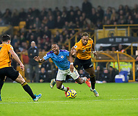 27th December 2019; Molineux Stadium, Wolverhampton, West Midlands, England; English Premier League, Wolverhampton Wanderers versus Manchester City; Adama Traore of Wolverhampton Wanderers pushes over Raheem Sterling of Manchester City whilst he had the ball at his feet leading to a free kick - Strictly Editorial Use Only. No use with unauthorized audio, video, data, fixture lists, club/league logos or 'live' services. Online in-match use limited to 120 images, no video emulation. No use in betting, games or single club/league/player publications