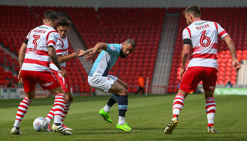 Blackpool's Kyle Vassell is outnumbered by Doncaster Rovers' Niall Mason, Danny Andrew and Andrew Butler<br /> <br /> Photographer Alex Dodd/CameraSport<br /> <br /> The EFL Sky Bet League One - Doncaster Rovers v Blackpool - Saturday 19th August 2017 - Keepmoat Stadium - Doncaster<br /> <br /> World Copyright &copy; 2017 CameraSport. All rights reserved. 43 Linden Ave. Countesthorpe. Leicester. England. LE8 5PG - Tel: +44 (0) 116 277 4147 - admin@camerasport.com - www.camerasport.com