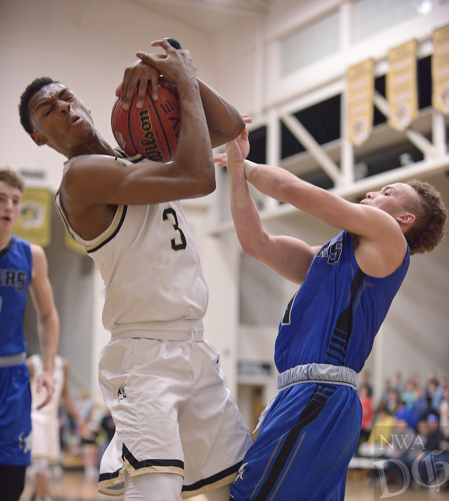 NWA Democrat-Gazette/BEN GOFF @NWABENGOFF<br /> Jordan Hemphill (left) of Bentonville wins a rebound over Milacio Freeland of Rogers on Saturday Jan. 23, 2016 during the game in Bentonville's Tiger Arena.