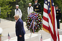 United States President Donald J Trump walks away as he, US Vice President Mike Pence, and First lady Melania Trump commemorate Memorial Day by participating in a Wreath Laying ceremony the Tomb of the Unknown Soldiers at Arlington National Cemetery in Arlington, Virginia on Monday, May 25, 2020.<br /> Credit: Chris Kleponis / Pool via CNP/AdMedia