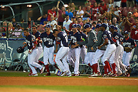 Reading Fightin Phils pinch hitter Rene Garcia (6) is mobbed by teammates including Zach Eflin (16), Hoby Milner (25), Harold Martinez (17), Stephen Shackleford (34), Destin Hood (7) after a walk off base hit during a game against the New Britain Rock Cats on August 7, 2015 at FirstEnergy Stadium in Reading, Pennsylvania.  Reading defeated New Britain 4-3 in ten innings.  (Mike Janes/Four Seam Images)
