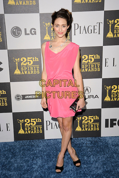 EMMY ROSSUM.The 25th Annual Film Independent Spirit Awards at the LA Live Event Deck in Los Angeles, California, USA..March 5th, 2010  .full length pink velvet dress ruched gathered sleeveless black open toe shoes clutch bag .CAP/ROT.©Lee Roth/Capital Pictures
