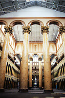 Washington D.C. : Pension Building, 1882-1887. 8 great Corinthian columns, 75 ft. high, 8 ft. diameter at base: brick, painted to look like siena marble.  National Building Museum since 1985. Photo '91.