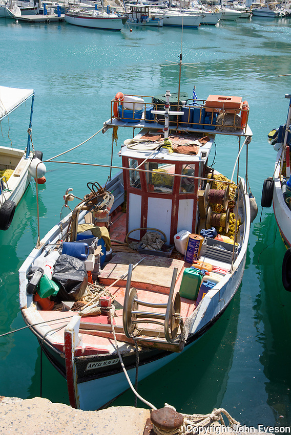 A fishing boat in the port at Heraklion, the largest city and the administrative capital of the island of Crete. It is the fourth largest city in Greece