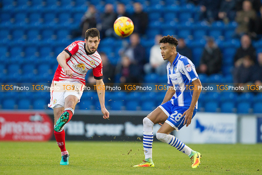 Danny Hollands of Crewe Alexandra clears from Kurtis Guthrie of Colchester United during Colchester United vs Crewe Alexandra, Sky Bet EFL League 2 Football at the Weston Homes Community Stadium on 26th November 2016