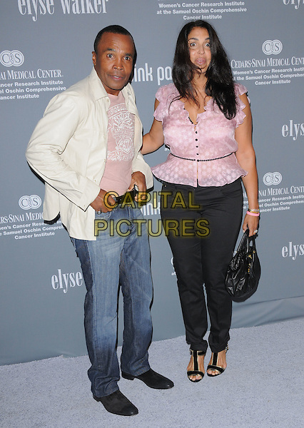 SUGAR RAY LEONARD .Attends The 4th Annual Pink Party held at Santa Monica Airport Hanger 8 in Santa Monica, California, USA, .September 13th 2008.                                                                     .full length jeans white jacket pink shirt blouse black trousers bag .CAP/DVS.©Debbie VanStory/Capital Pictures