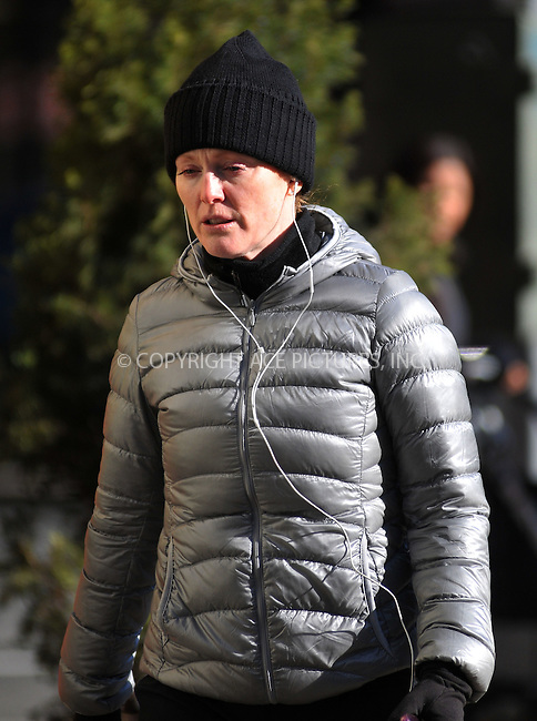 WWW.ACEPIXS.COM . . . . .  ....January 9 2012, New york City....Actress Julianne Moore was out for a jog in the West Village on January 9 2012 in New York City....Please byline: CURTIS MEANS - ACE PICTURES.... *** ***..Ace Pictures, Inc:  ..Philip Vaughan (212) 243-8787 or (646) 679 0430..e-mail: info@acepixs.com..web: http://www.acepixs.com