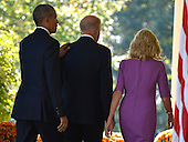 United States  President Barack Obama (L) places his hand on the shoulder of  Vice President Joe Biden as they walk the colonnade with Dr. Jill Biden after Biden announced he will not be seeking the Democratic presidential nomination in 2016 in the Rose Garden of the White House, October 21, 2015, in Washington, DC. <br /> Credit: Mike Theiler / Pool via CNP