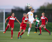 McCall Zerboni (7) of the Western NY Flash goes up for a header over Ingrid Wells (9) of the Washington Spirit during the game at the Maryland SoccerPlex in Boyds, MD.  Washington tied Western NY, 1-1.