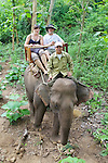 Eva & Bill Riding An Elephant