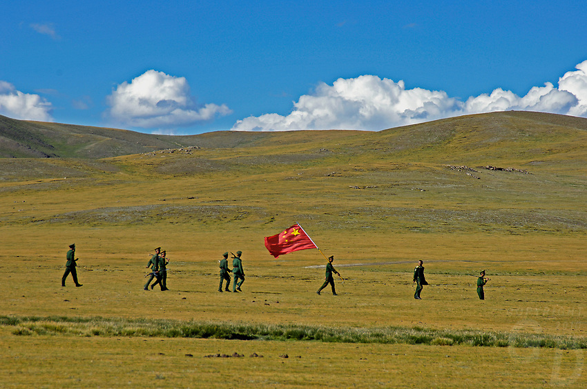 Chinese Soldiers with Chinese Flag in Tibet's province of Nakchu in Tibet hosts many festivals throughout the year, but one stands out more than any other; it is the highest horse racing festival in the world – a spectacle of colour, festivities and endurance for participants and visitors alike.<br />