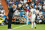 Head coach Zinedine Zidane of Real Madrid talks to Luka Modric of Real Madrid during their La Liga match at the Santiago Bernabeu Stadium between Real Madrid and RC Celta de Vigo on 27 August 2016 in Madrid, Spain. Photo by Diego Gonzalez Souto / Power Sport Images