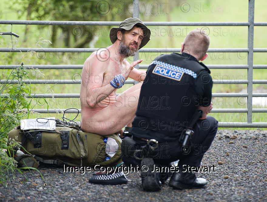 Naked rambler Stephen Gough talks to a police officer from Fife Constabulary prior to being arrested outside the village of Townhill, north of Dunfermline.