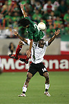 1 March 2006: Mexico's Francisco Rodriguez (2) tumbles over Ghana's Elvis Hammond (14) as the ball sails past. The National Team of Mexico defeated the National Team of Ghana 1-0 at Pizza Hut Park in Frisco, Texas in an International Friendly soccer match.