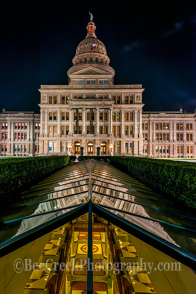 This is verticale view of the Texas State Capital in downtown Austin at night.  We like the way you can see into the floors below the capitol from the skylight. We have takend this photo before and will probably take it again.