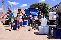 Residents of Sao Jose do Egito, Pernambuco state,  fill water buckets from neighborhood tanks. With the local reservoirs dry, all water in the city in the Semi-arid region known as the sertao must be trucked in. Those who can afford it pay to have their home cisterns filled, while others must get wait for government trucks to fill the community tanks. The region has dry season every year, but 2012 is considered the worst in 30 years.