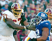 Landover, MD - December 24, 2005 -- New York Giants defensive end Michael Strahan (92) tries to elude Washington Redskin offensive lineman Ray Brown (67) in game action at FedEx Field in Landover, MD on December 24, 2005.  The Redskins won the game 35 - 20..Credit: Ron Sachs / CNP.(RESTRICTION: NO New York or New Jersey Newspapers or newspapers within a 75 mile radius of New York City)
