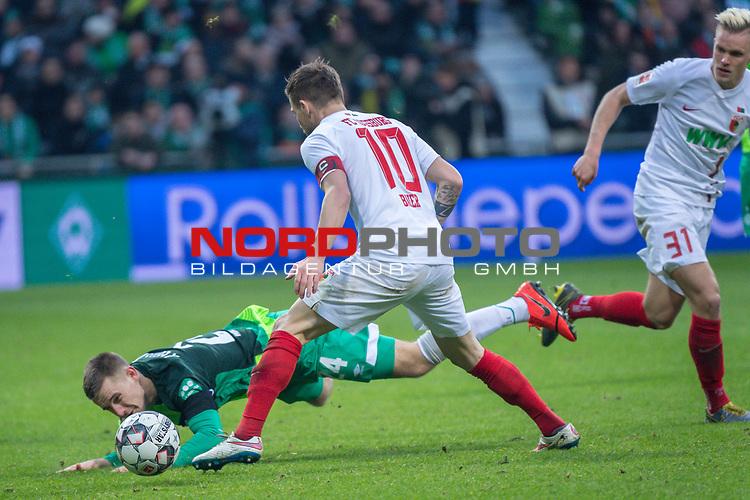 10.02.2019, Weser Stadion, Bremen, GER, 1.FBL, Werder Bremen vs FC Augsburg, <br /> <br /> DFL REGULATIONS PROHIBIT ANY USE OF PHOTOGRAPHS AS IMAGE SEQUENCES AND/OR QUASI-VIDEO.<br /> <br />  im Bild<br /> Rani Khedira (FC Augsburg #08)<br /> Johannes Eggestein (Werder Bremen #24)<br /> Daniel Baier (FC Augsburg #10)<br /> <br /> <br /> Foto &copy; nordphoto / Kokenge