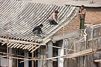 Builders and roofers viewed from The City Wall, Xian, China