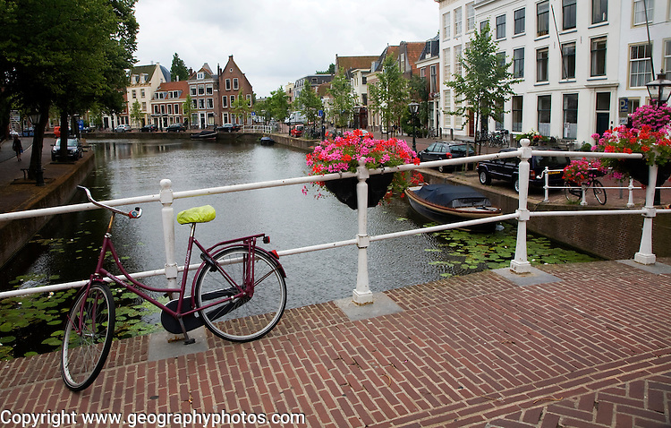 Typically Dutch view of bicycle on a canal bridge, Leiden, Netherlands