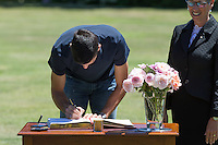 February 1, 2016: Novak Djokovic of Serbia signs the visitor's book with Her Excellency the Honourable Linda Dessau AM<br /> Governor of Victoria looking on during the Men's Champion Photocall  at Government House, Melbourne, Australia. Photo Sydney Low